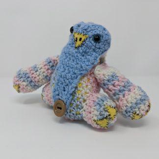 hand made crocheted baby owlbear dice bag