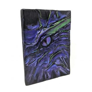 black leather dragon eye journal cover in shades of purple and green