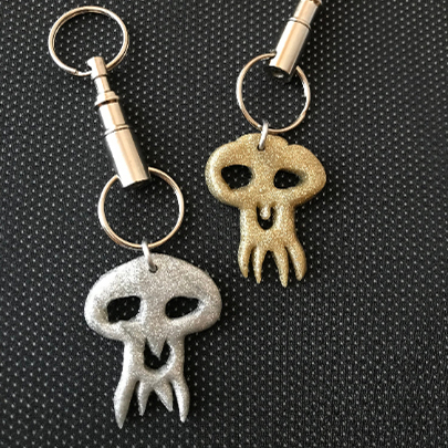 Gold and Silver Skull Keychains